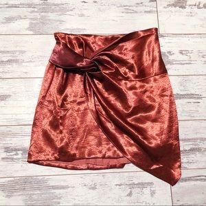 Silky burnt orange asymmetrical mini skirt